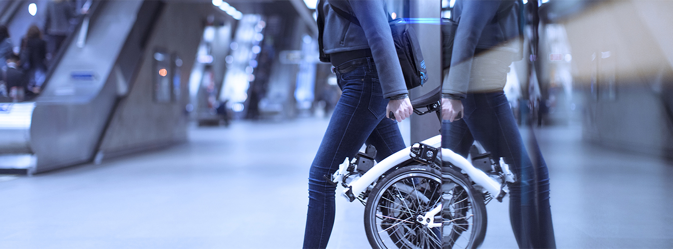 folding electric bike at train station
